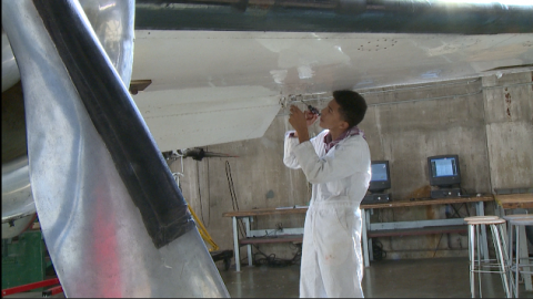 Student working on airplane