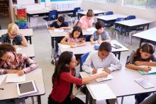 Students taking test in classroom
