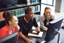 happy students working at a computer together