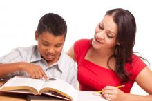 boy reading with teacher