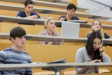 Students attending class in a lecture hall