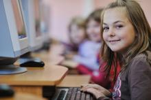 Girl sitting at a computer