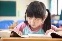 girl reading in classroom