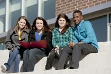 students studying together outside on steps