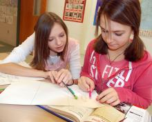 Students discussing text they've read.