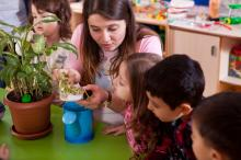 Students teacher with plant