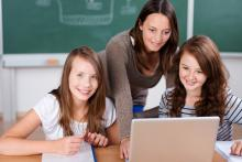 Two students at laptop
